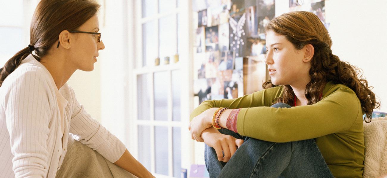 image of two women speaking